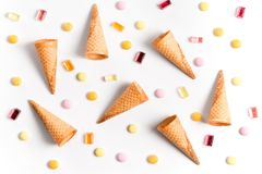 Ice cream cones and candy lay flat image wallpaper. On white background stock photos