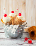 Ice cream cones with cherry Stock Images