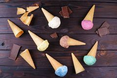 Ice cream cones and chocolate on table, flat lay Stock Images