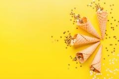 Ice cream cones with golden stars stock photo