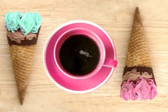 Ice cream cones and hot coffee cup on wooden vintage background Royalty Free Stock Photography