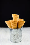 Ice cream cones in a metal bucket Royalty Free Stock Images