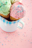 Ice cream cones in an old mug in pink background Stock Photos