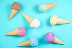 Ice cream cones on table,flat lay. Food background. Various ice cream cones on blue table, flat lay. Food background, summer refreshing concept, traditional royalty free stock image