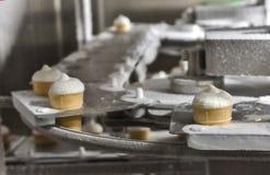 Ice cream on a conveyor belt stock photos