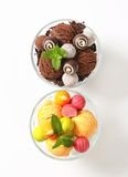 Ice cream coupes with chocolate truffles and pralines Stock Images