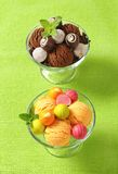 Ice cream coupes with chocolate truffles and pralines Royalty Free Stock Images