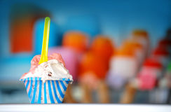 Ice cream cup. Delicious ice cream and multicolor cups faded background Royalty Free Stock Image