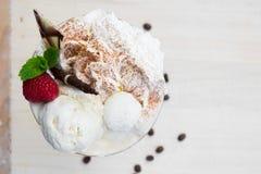 Ice cream cup with fresh fruit Stock Photos