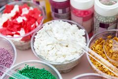 Ice cream and cupcakes sprinkle non pareil toppings and decorations Stock Image