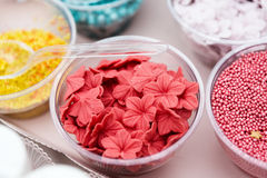 Ice cream and cupcakes sprinkle non pareil toppings and decorations Royalty Free Stock Photo