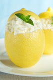 Ice cream. In cups of lemon, decorated with mint Stock Photos