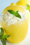 Ice cream. In cups of lemon, decorated with mint Stock Photography