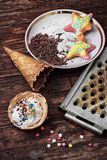 Ice cream decorated with sweet powder in the wafer Royalty Free Stock Photos