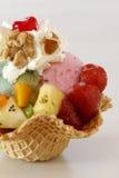 Ice cream dessert. With fresh fuits, nuts and cream Stock Photos