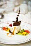 Ice cream dessert served with fruits Stock Photos