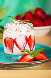 Ice cream dessert with strawberries. On blue plate Stock Images