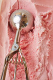 Ice cream disher forming scoop Royalty Free Stock Photo