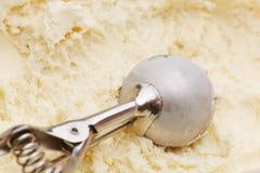 Ice cream disher in vanilla ice cream Royalty Free Stock Photo