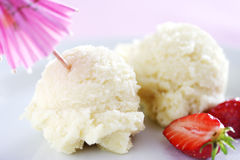 Ice cream an dstrawberries. 2 scoops of ice cream with decor stock photo