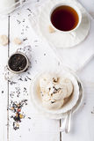 Ice cream with Earl grey tea flavor. White ceramic bowl. Ice cream with Earl grey tea flavor in white ceramic bowl on a white wooden background Stock Images