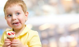 Ice cream eating by kid Stock Images