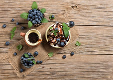 Ice cream with fresh blueberries and leaves from top on table Royalty Free Stock Photos