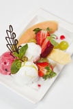 Ice cream with fresh fruits Stock Photography
