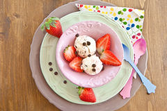 Ice cream with fresh strawberries Stock Images