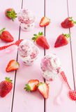 Ice cream with fresh strawberries Stock Image