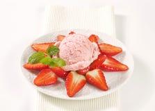 Ice cream with fresh strawberries Stock Photos