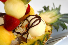 Ice cream with fruits. In pineapple stock photo