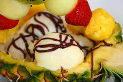Ice cream with fruits. In pineapple stock image