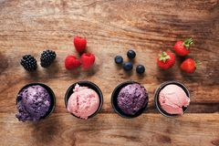 Ice cream and fruits Stock Photos