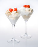 Ice-cream a glass. Ice-cream with a cherry in a glass on a white background royalty free stock photography