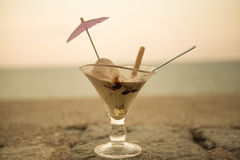Ice cream in a glass beaker on a beautiful background of sea sunset. Royalty Free Stock Images