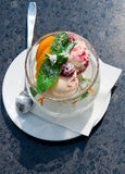 Ice cream in a glass on a black table Royalty Free Stock Photography