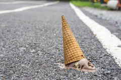 Ice cream on the ground. Royalty Free Stock Photography