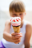 Ice cream held by young girl Stock Photography