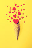 Ice Cream Horn or Cone with Sweethearts on a Yellow Background. Stock Photography