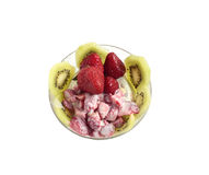 Ice cream with a kiwi and strawberry. Ice cream with the pistachios, three berries of strawberry and kiwi segments in glasswares Stock Image