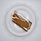 Ice-cream Lakomka ice-cream in melted chocolate on a white plate on a saucer with napkin isolated on white background Stock Photos
