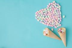 Ice cream lovу concept, flat lay waffle cone on plain blue background Royalty Free Stock Photos