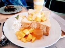 Ice cream and mango on bread. stock photo