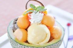 Ice cream and melon Stock Photos