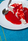 Ice cream meringue cake with strawberry topping Stock Image