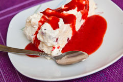Ice cream meringue cake with strawberry topping Royalty Free Stock Photo