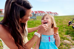 Ice cream mom daughter Stock Photos