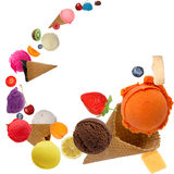 Ice cream in motion. Ice cream scoops with fruits in motion Stock Photos