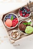 Ice cream with nuts and berries Royalty Free Stock Photography